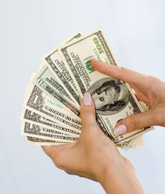 foto of holding money  - A lot of dollars in hands - JPG
