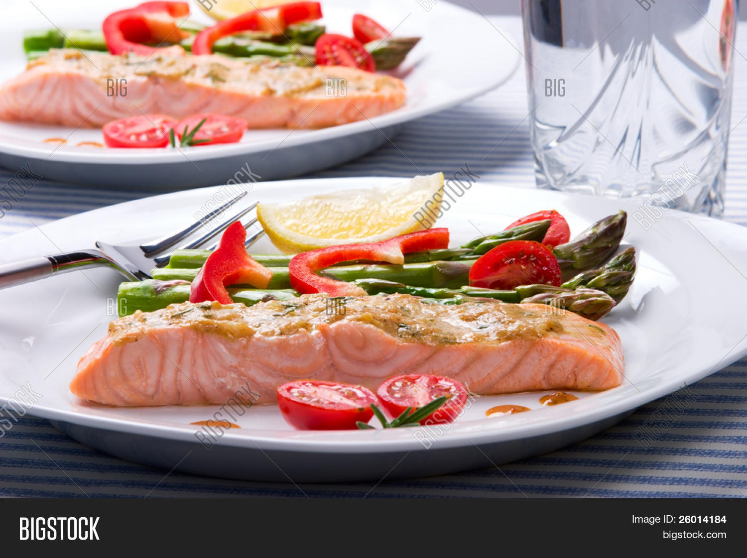 Rosemary roasted salmon served with asparagus, cherry ...