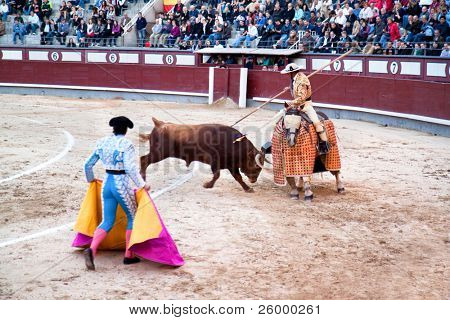 MADRID, SPAIN - OCTOBER 17: The horseback picador continues to stab the bull's neck leading to the animal's first major loss of blood and makes him ready for the next stage. October 17, 2010, Spain