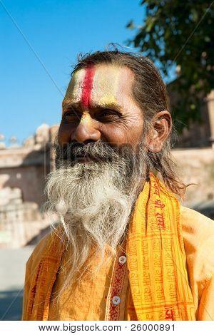 ORCHHA, INDIA -17 FEBRUARY: Spiritual Guru Shaiva sadhu (holy man) in front of a  Raj Mahal , February 17, 2008. Orchha, Madhya Pradesh, India