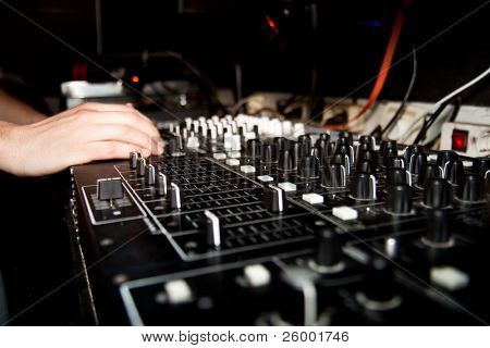DJ is mixing music on music console. Music device. Element of design.
