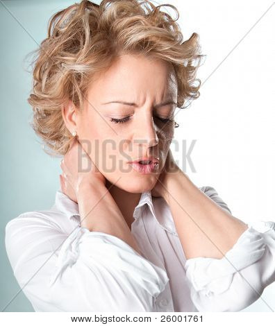 Woman with pain in her neck, Isolated medical shot over white background.
