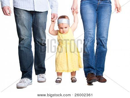 Happy family. Father, mother and baby's first steps