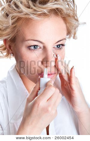 Woman  use an  bronchial inhale, studio shot