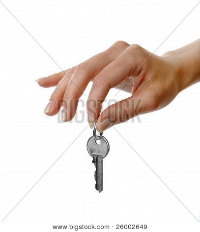 Womans Hand Holding A Key