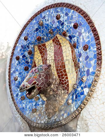 Mosaic Dragon made of broken ceramic tiles in Park Guell designed by Antoni Gaudi , Barcelona, Spain