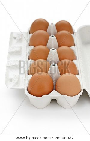 Brown eggs in box on white background