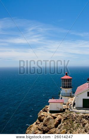 Blue sky seascape with lighthouse on remote cape
