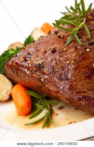 Roasted beef loin tri-tip, garnished with vegetables