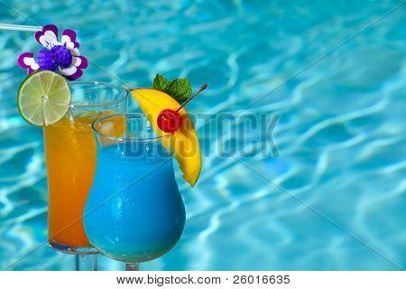 Blue Hawaiian and Mai Tai cocktails on swimming pool side