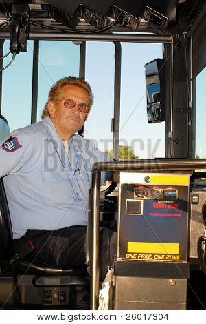 City bus driver at the wheel.