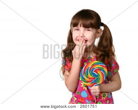 Happy Young Girl Laughing Holding Lollipop