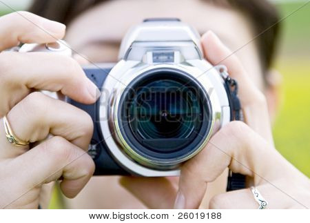 Woman shooting with point and shoot camera