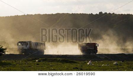 Trucks working on highway building