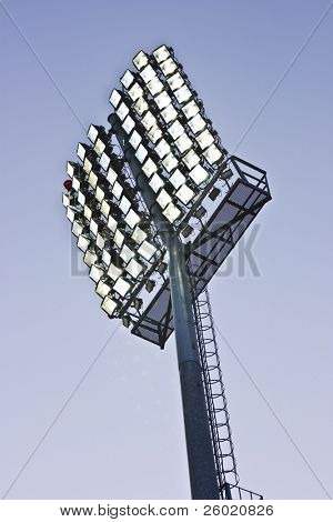 Stadium lights and blue sky