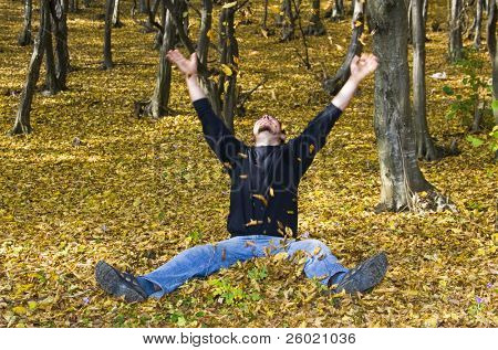 Young handsome man in autumn forest