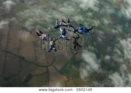 Eight Skydivers Buillding A Formation