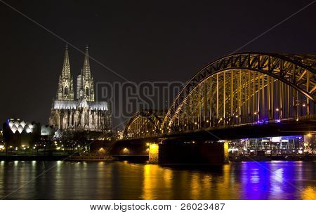 Koln - April 2: Night shot of Cologne dom and Hohenzollern bridge April 2, 2009 in Cologne, Germany