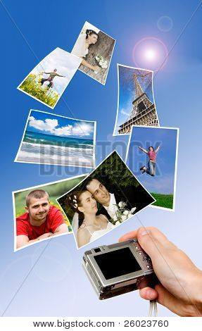 Digital camera and photographs against blue background