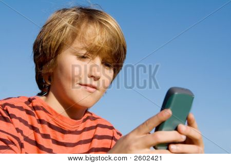 Child With Cell Or Mobile Phone