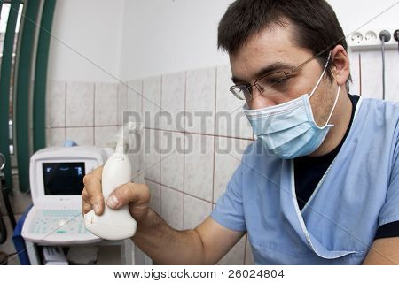Doctor looking at modern ultrasound device