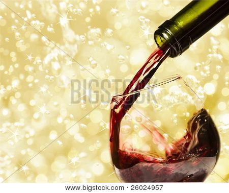 Pouring red wine and holiday lights