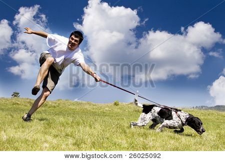 Man playing with his dog on sunny summer day