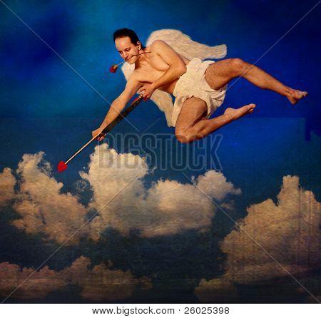 Flying Cupid on vintage postcard