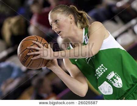 CLUJ-NAPOCA, ROMANIA - MARCH 3: Woman basketball player in action at a Romanian National Championship basketball game U Mobitelco vs LMK Sf. Gheorghe March 3, 2010 in Cluj-Napoca, Romania.