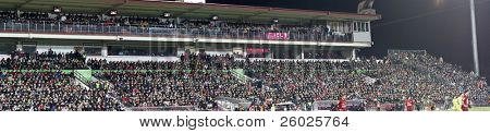 CLUJ-NAPOCA, ROMANIA - FEBRUARY 28: Panoramic view of supporters at a Romanian National Championship soccer game CFR Cluj vs. Steaua Bucuresti, February 28, 2010 in Cluj-Napoca, Romania.