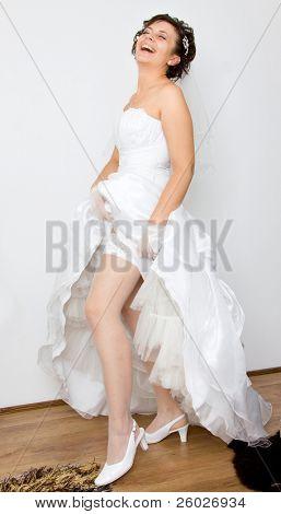 Bride shoving her stockings