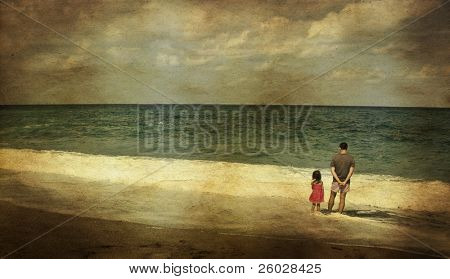 Vintage photo of a father with his daughter on the beach