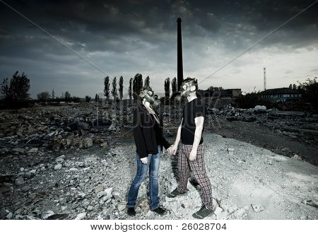 Bizarre portrait of romantic couple with gas masks