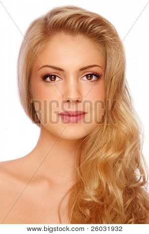 Young beautiful girl with long curly fair hair and clear make-up on white background
