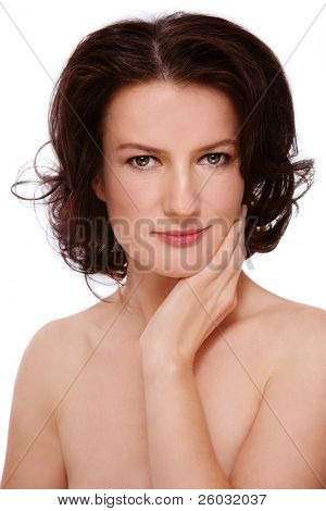 Portrait of attractive groomed healthy middle-aged woman touching her face, on white background