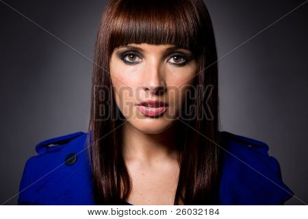 Headshot of an attractive brunette caucasian model looking directly at camera