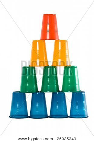Pyramid from multi-coloured disposable plastic glasses isolated on white background
