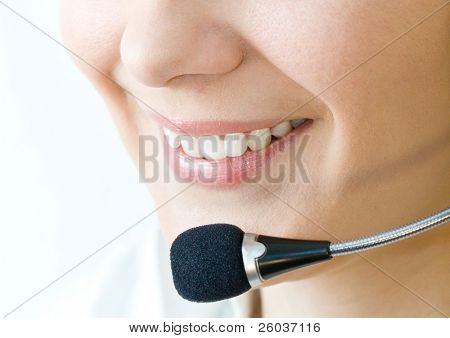 Smiling woman operator with headset close-up