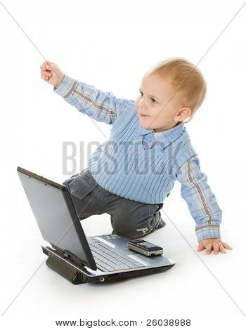 Concept of little businessman: yes, success! Child and laptop. Isolated on white background