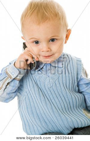 Concept of little businessman. Child speak on the phone. Isolated on white background
