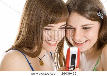 Two pretty girls reading SMS on mobile phone isolated on white background
