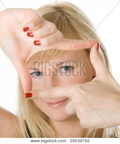Young blonde woman looking through a frame made by her fingers. Isolated on white background