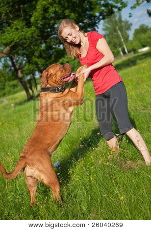 Young girl and her dog (French mastiff, Dogue de Bordeaux)