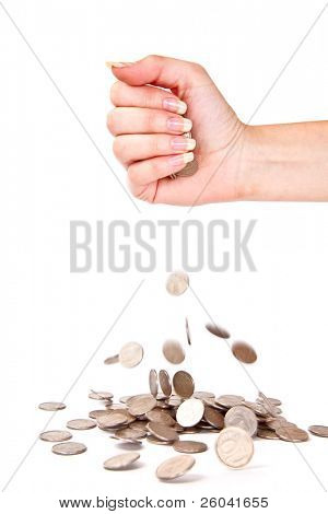 Hand and coins are failing down. Isolated on white background