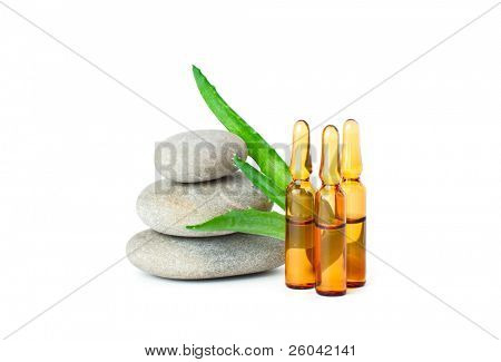 Group of medicine ampules, stones and aloe. Isolated on white background