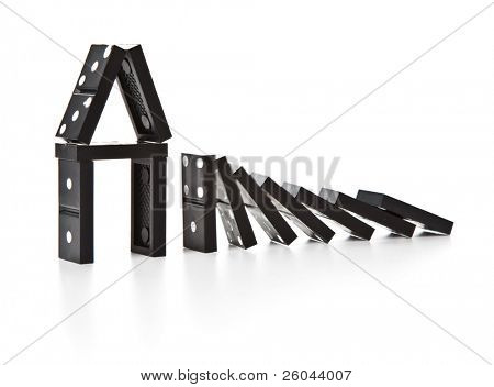 Stack of dominoes falling. Isolated on a white background