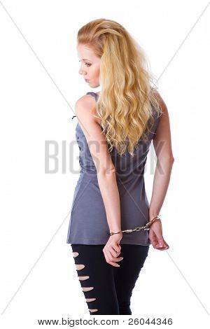 Blond woman with handcuffs. Isolated on white background