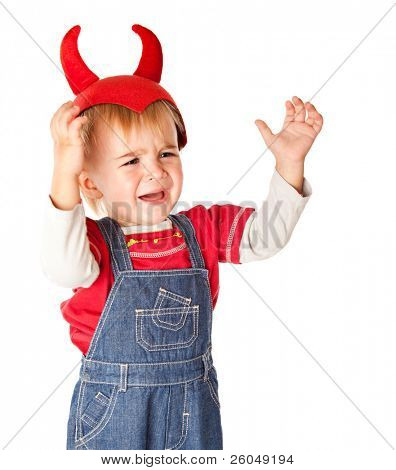 A crying boy in a funny hat. Isolated on a white background