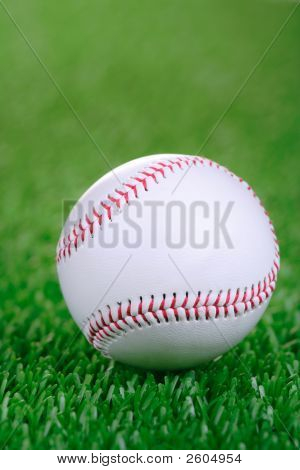 Baseball Ball Against Grass Background