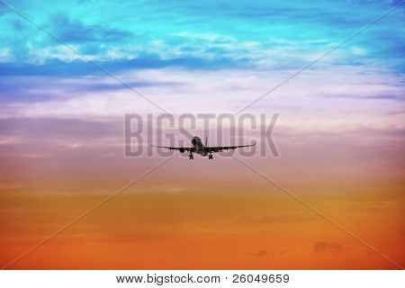 Passenger Plane Takes Off At Sunset